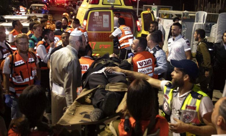 """Photo of Israeli police poised for arrests after 12-year-old boy dies in """"unfinished"""" synagogue collapse"""