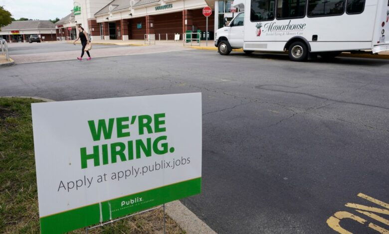 Photo of U.S. jobless claims tick down to 411,000 as economy heals