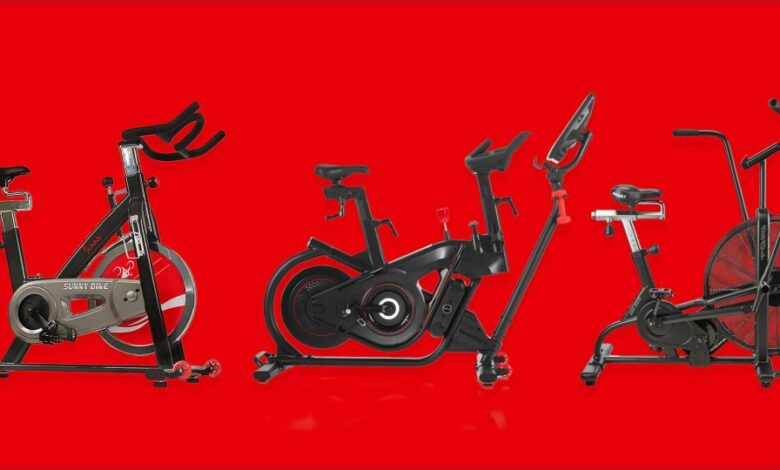 Three exercise bikes on red background