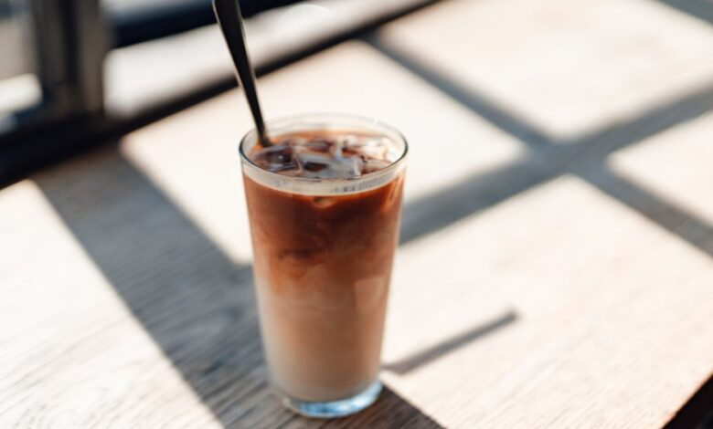 Iced coffee in a glass by a window