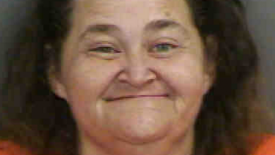 Photo of Naked Toothless Woman Found Huffing Propane Tank Threatens To Blow Up Police